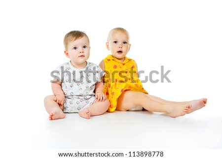 happy children play on the floor isolated on white background