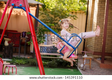 happy children play on the swings