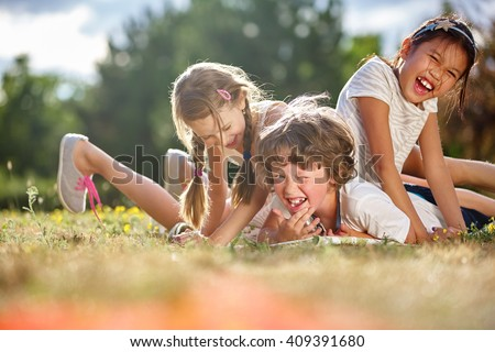 Happy children playing and having fun in summer  - stock photo