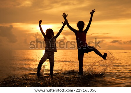 Father Son Jumping Sunset Beach Happy Stock Photo ...