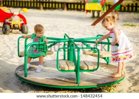 happy children playing on the playground - stock photo
