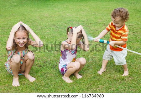 Happy children pours a water - stock photo