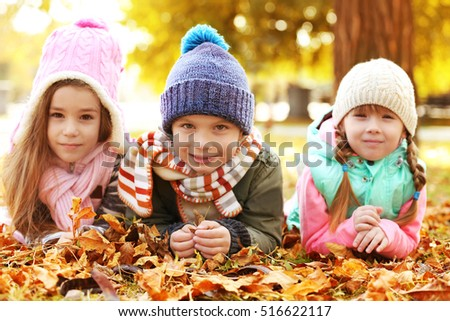 Happy children resting in beautiful autumn park