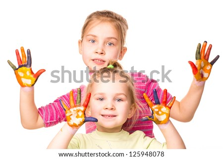 Happy children showing hands painted in bright colors, isolated over white - stock photo