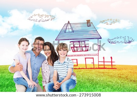 Happy children sitting on parents laps against blue sky over green field - stock photo