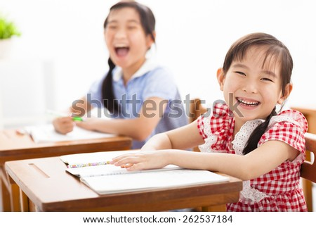 happy children study in the classroom - stock photo