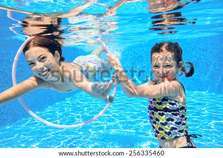 Kids Swimming Underwater happy active kids play underwater swimming stock photo 206643610