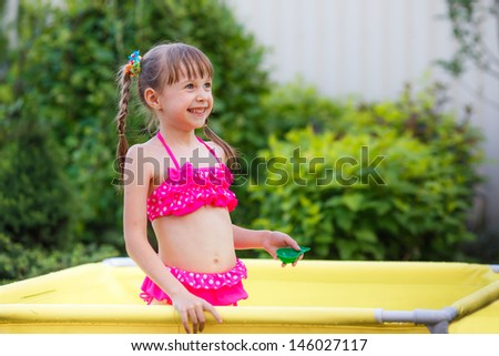 happy children swimming in the pool