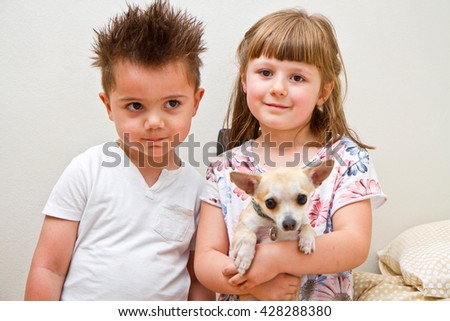 happy children with a  dog