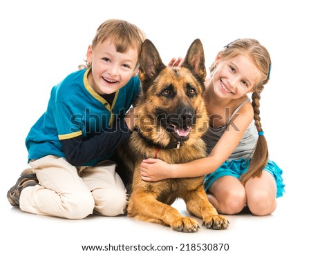happy children with a shepherd dog isolated  on a white background - stock photo