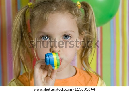 Happy children with birthday cake ona striped background - stock photo