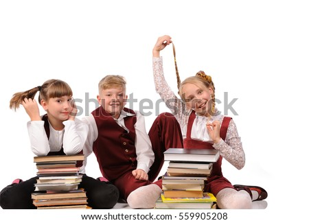 happy children with books siiting on the floor isolated over white background