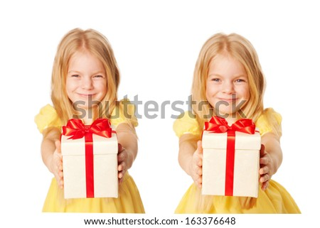 Happy children with gifts. Twins, two little sisters, two similar girls giving presents. Holiday and Christmas concept. - stock photo