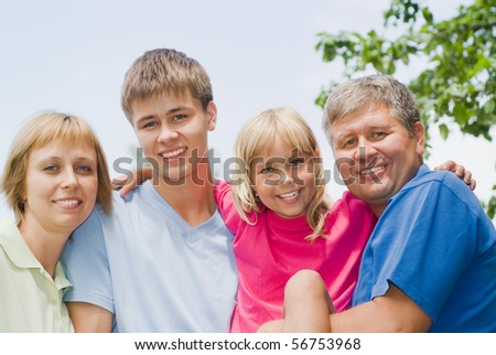 happy children with parents in the summer park - stock photo