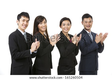 Happy Chinese business team celebrating success. Isolated on white background - stock photo