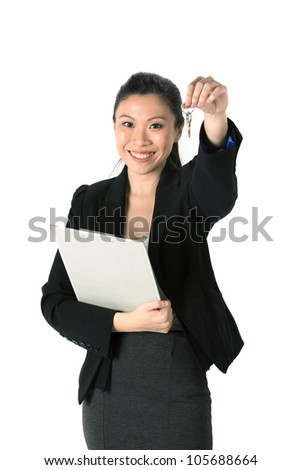 Happy Chinese business woman or realtor showing keys. Isolated over white background. - stock photo