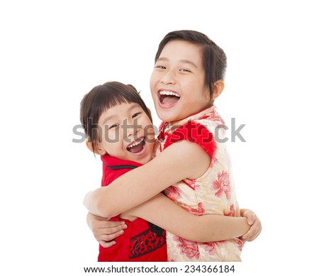 happy chinese little Girls  and Giving One Another Hug  - stock photo