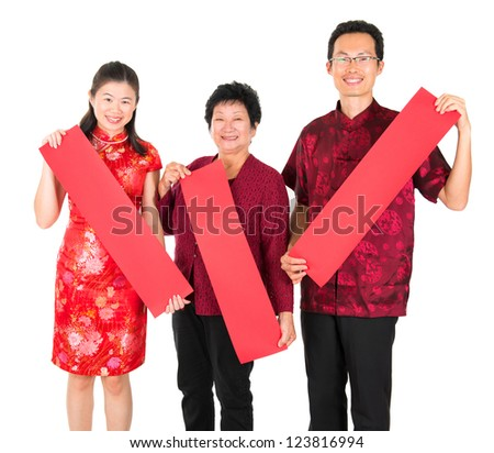 Happy chinese new year. Asian Chinese family holding red spring couplets, ready for text standing over white background