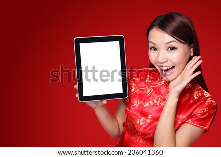 happy Chinese new year. beautiful young Asian woman holding tablet pc with empty screen isolated on red background - stock photo