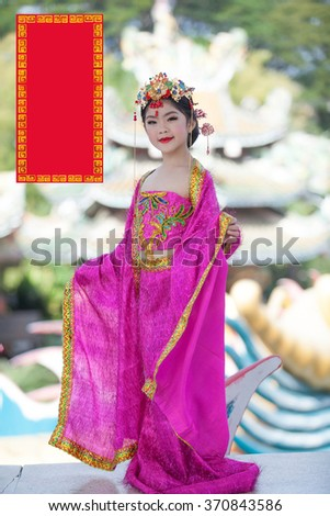 Happy chinese new year concept label stock photo royalty free happy chinese new year concept label greeting and smiling little girls traditional chinese dress m4hsunfo