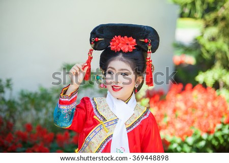 Happy Chinese new year concept . smiling  little girls Traditional Chinese dress. (Place Public Temple in Thailand ,Traditional Chinese dress is common in Thailand and is not subjected to copyright)
