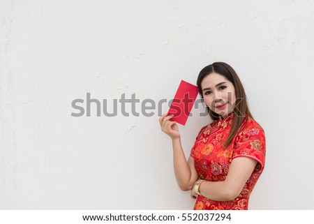 happy chinese new year portrait of asian woman has red envelope on white wall
