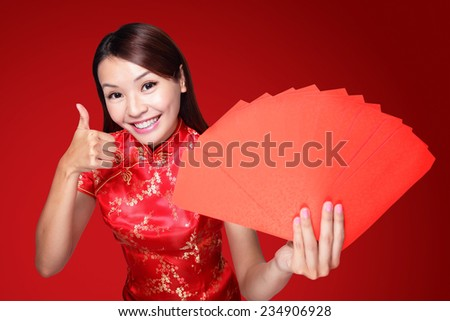 happy chinese new year. smile asian woman holding red envelope isolated on red background - stock photo