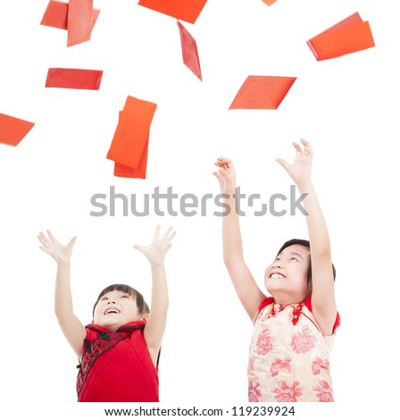 happy chinese new year.two asian kids trying to catch red envelope for good luck and rich - stock photo