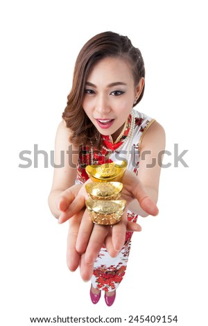Happy chinese new year. Woman pointing show gold at camera above in high angle view. Wide angle, almost fish eye effect. Smiling mixed chinese asian / caucasian woman. Isolated on white background. - stock photo