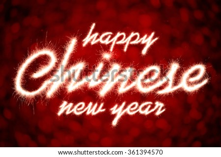 Happy Chinese New Year written with Sparkle firework - stock photo