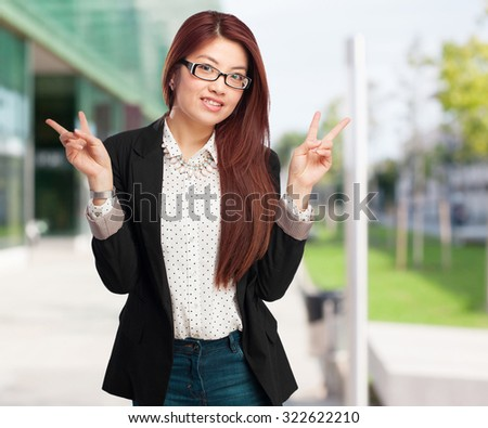happy chinese woman celebrating gesture - stock photo