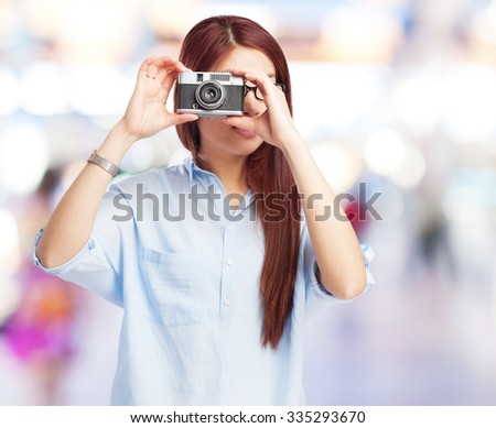 happy chinese woman with camera - stock photo