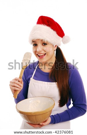 Happy christmas chef about to lick cake mixture on white background - stock photo