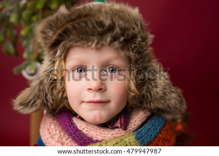 Happy Christmas Child in winter hat: Holiday, x-mas setting