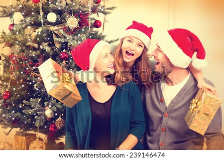 Happy Christmas Family with Christmas gifts. Smiling Parents with teenage daughter at Home Celebrating New Year. Christmas Tree  - stock photo