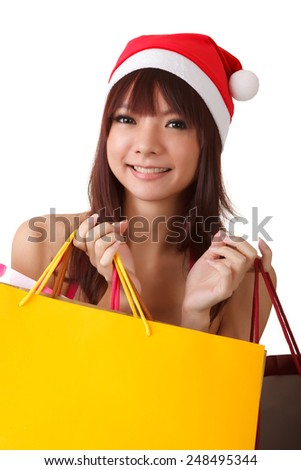 Happy Christmas girl holding shopping bags.