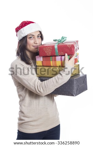 Happy Christmas girl with many gifts isolated on white background