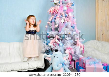Happy Christmas - Little pretty girl and Christmas tree - stock photo