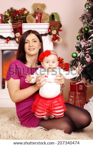 happy Christmas mother and baby on fur