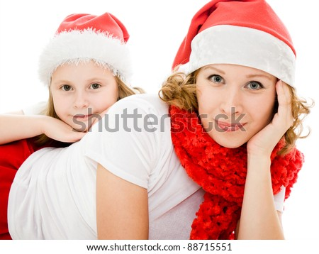 Happy Christmas mother and daughter on a white background.