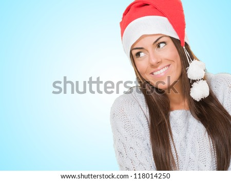 Happy christmas woman looking up against a blue background