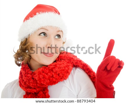 Happy Christmas woman points a finger upward on a white background.