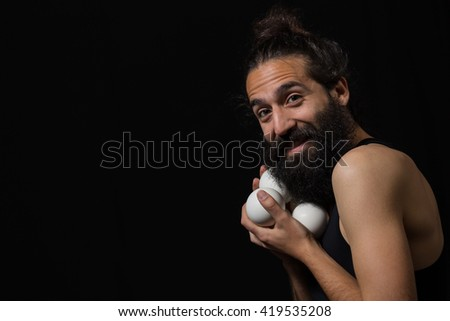 Happy circus juggler miming with his juggling balls during a performance - stock photo