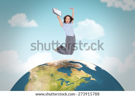 Happy classy businesswoman jumping while holding clipboard against blue sky - stock photo