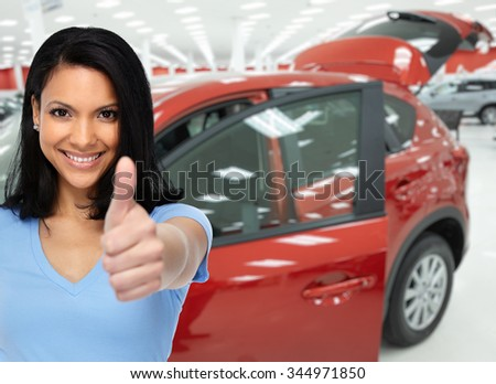 Happy client woman near cars. Auto dealership and rental concept background. - stock photo