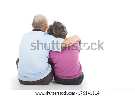 Happy closeness senior couple sitting on the floor - stock photo