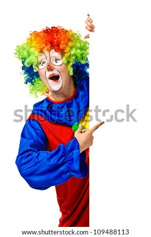 Happy clown holding the blank board and pointing. Isolated