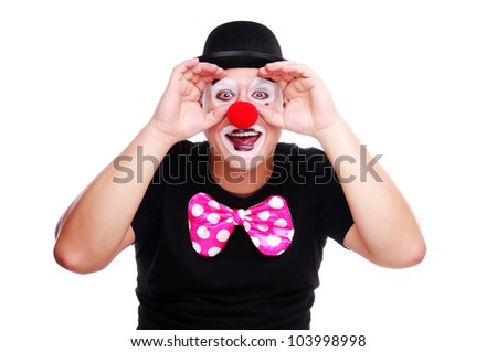 Happy clown looking through imaginary binocular - stock photo