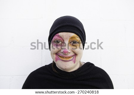 Happy clown makeup, celebration and party girl - stock photo