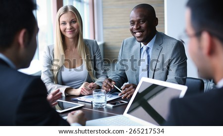 Happy colleagues having friendly talk at meeting - stock photo